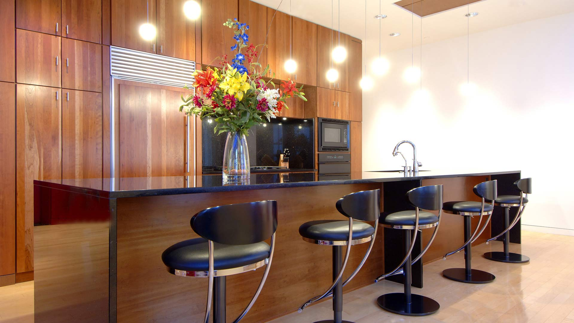 Downtown Urban Modern Penthouse - Galley Kitchen with Cherry Cabinetry - HAUS Architecture, Christopher Short, Indianapolis Architect