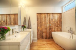 Broad Ripple Bungalow - Borrowed Light Wall-Hung Vanities Master Spa Reclaimed Wood Barn Door Freestanding Modern Tub - HAUS Architecture, WERK Building Modern, Christopher Short, Indianapolis Architect