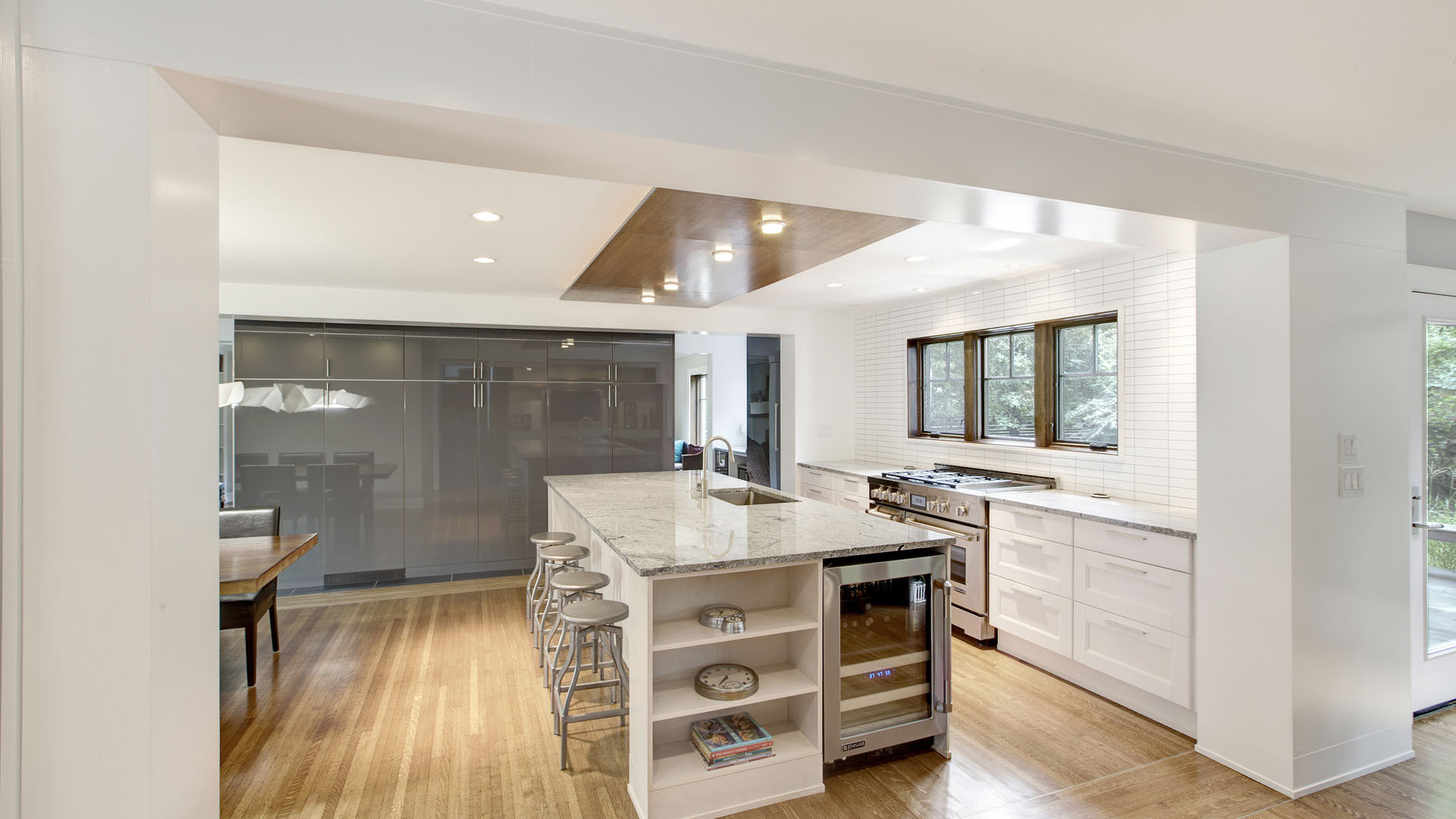 Classic Butler Tarkington Modern Tudor Renovation, Open Concept Kitchen with Large Full Height Storage Wall and Large Island Subway Tile Backsplash Stacked Bond Ceiling Cloud, HAUS Architecture, WERK Building Modern, Christopher Short, Indianapolis Architect