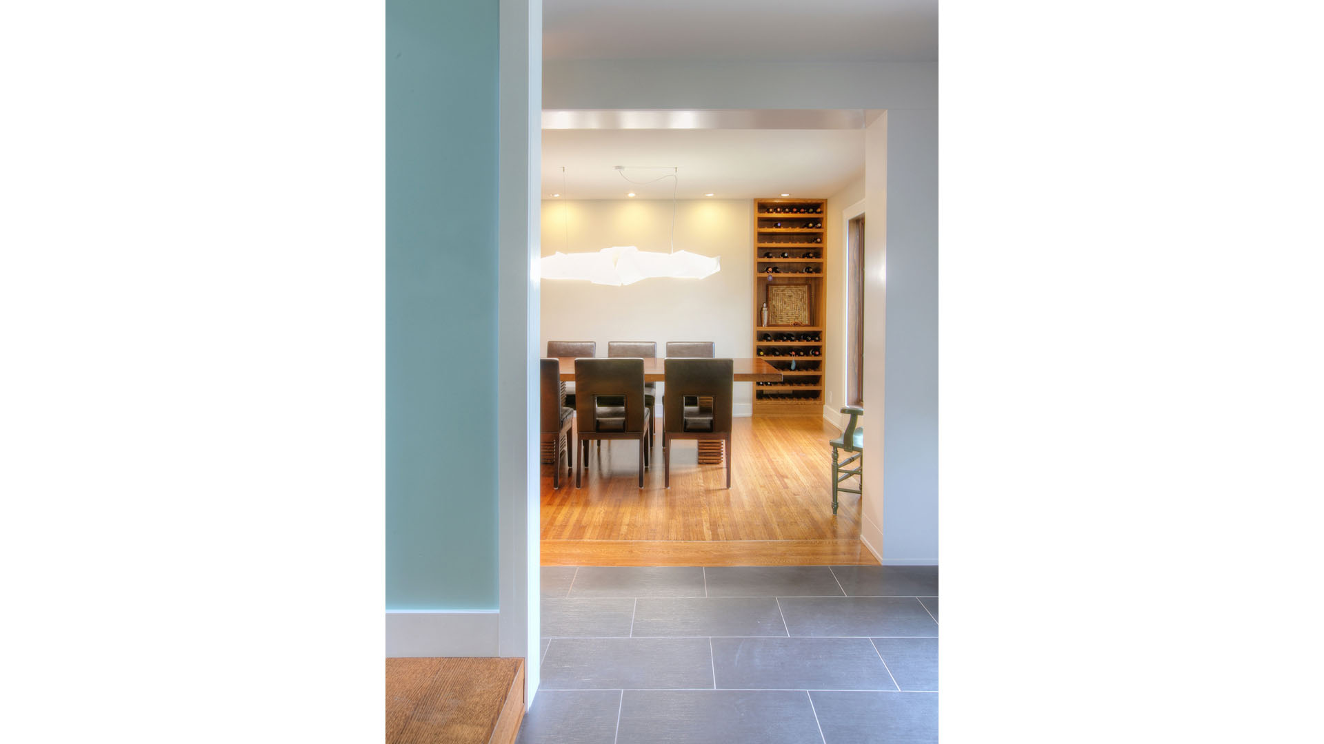Classic Butler Tarkington Modern Tudor Renovation, Front Entry Foyer with View into Dining Room with Wine Storage Nook and Modern Pendant Light Aqua Blue Walls, HAUS Architecture, WERK Building Modern, Christopher Short, Indianapolis Architect