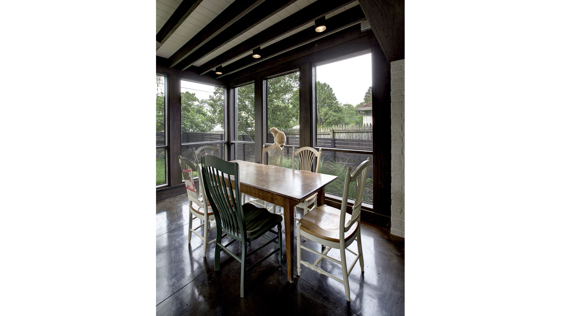 Classic Butler Tarkington Modern Tudor Renovation, Three Sided Flat Roof Family Screened Porch Dining Table Cat Concrete Floors, HAUS Architecture, WERK Building Modern, Christopher Short, Indianapolis Architect