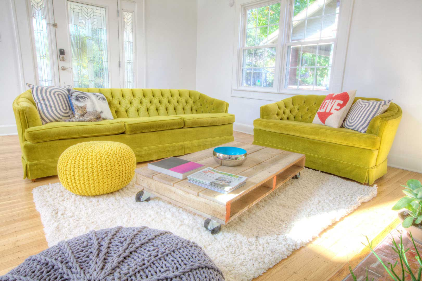 Broad Ripple Bungalow - Green Retro Sofas, Pallet Coffee Table on Wheels Poufs - HAUS Architecture, WERK Building Modern, Christopher Short, Indianapolis Architect