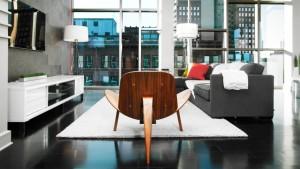 Urban Industrial Interior - Modern Wegner Chair and Skyline Views - HAUS Architecture, WERK Building Modern