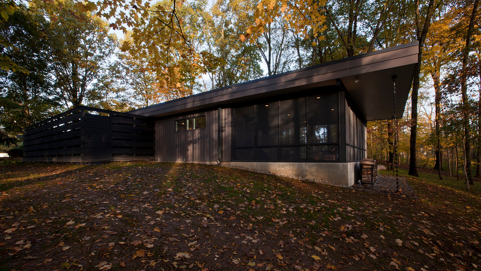 Screened Porch, wooded site, rainchains, privacy wall, privacy fence, cantilever flat roof, moss garden, sloping site, mid mod - Midcentury Modern Renovation - 81st Street - Indianapolis, Christopher Short, Architect, HAUS Architecture