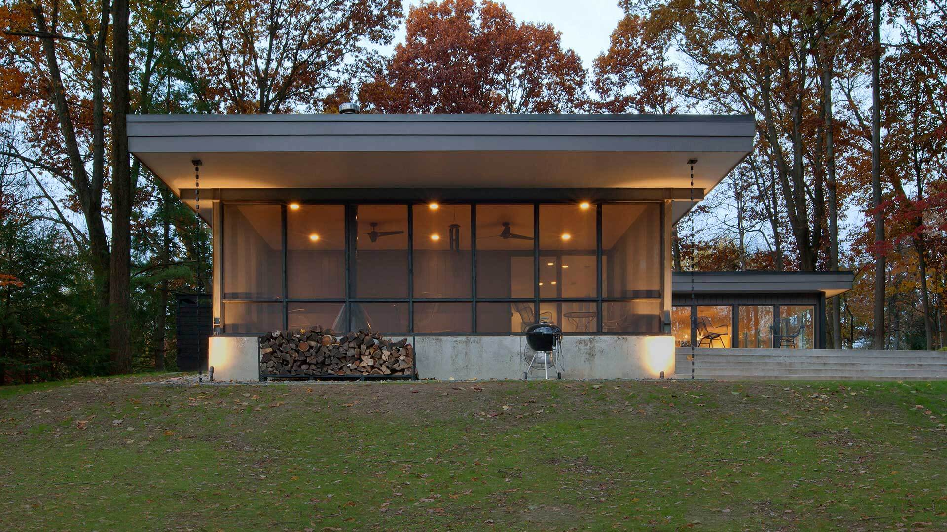 Screened Porch, Rainchain, Rain Chains, Weber Grille, Firewood, wooded site, private backyard terrace, concrete steps, steel structure, retro floating fireplace, porch ceiling fans, Midcentury Modern Renovation - 81st Street - Indianapolis, Christopher Short, Architect, HAUS Architecture