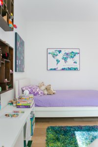 Playful child bedroom with colorful cubbies and wall storage, complete with world map and reading books, Natural wide plank white oak flooring, plush area rug, Midcentury Modern Renovation - 81st Street - Indianapolis, Christopher Short, Architect, HAUS Architecture, Jamie Sangar Photography