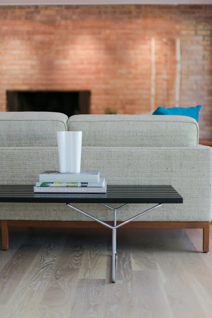 Original Mid Mod Fireplace, raised concrete hearth, modern furniture, large red area rugs, custom artwork, retro furnishings, inside out brick wall, exposed brick, leather side chairs, linen sofa, flokate pillow, wide plank oak flooring - Midcentury Modern Renovation - 81st Street - Indianapolis, Christopher Short, Architect, HAUS Architecture, Jamie Sangar Photography