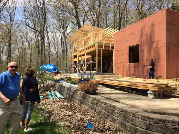 Our clients are having fun seeing the recent roof truss installation for the first time - Lakeside Modern Cottage - Unionville, Indiana, Lake Lemon - Christopher Short, Derek Mills, Paul Reynolds, Architects, HAUS Architecture + WERK   Building Modern - Construction Managers - Architect Custom Builders