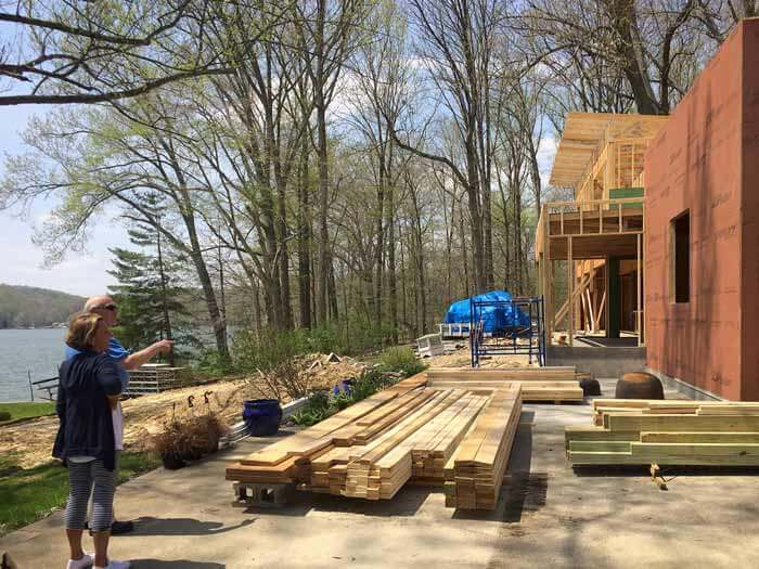 Our clients were excited to see recent progress, including the recent upper roof truss installations - Lakeside Modern Cottage - Unionville, Indiana, Lake Lemon - Christopher Short, Derek Mills, Paul Reynolds, Architects, HAUS Architecture + WERK | Building Modern - Construction Managers - Architect Custom Builders