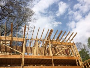 Wall and roof framing looking upward from lakeside elevation - Lakeside Modern Cottage - Unionville, Indiana, Lake Lemon - Christopher Short, Derek Mills, Paul Reynolds, Architects, HAUS Architecture + WERK | Building Modern - Construction Managers - Architect Custom Builders