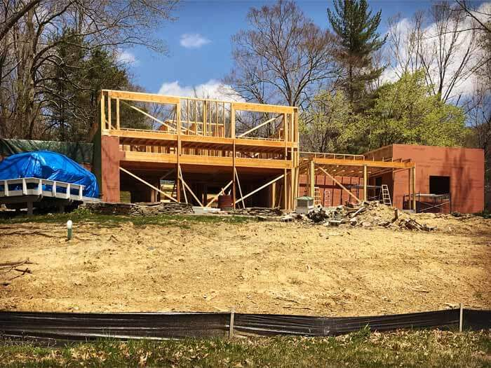 Main building forms beginning to take shape (viewed from lakeside) - Lakeside Modern Cottage - Unionville, Indiana, Lake Lemon - Christopher Short, Derek Mills, Paul Reynolds, Architects, HAUS Architecture + WERK   Building Modern - Construction Managers - Architect Custom Builders