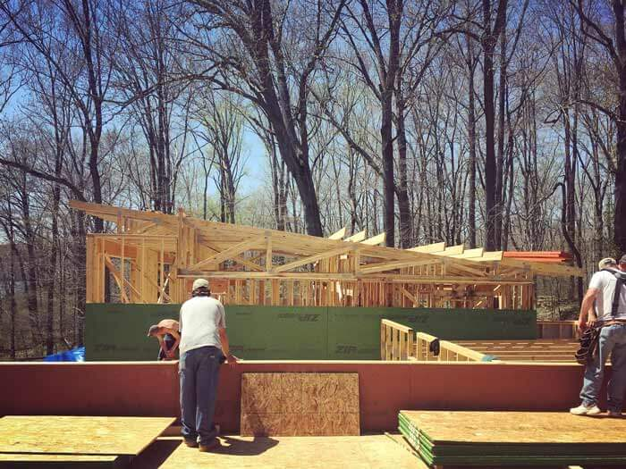 Truss and miscellaneous roof framing progressing - Lakeside Modern Cottage - Unionville, Indiana, Lake Lemon - Christopher Short, Derek Mills, Paul Reynolds, Architects, HAUS Architecture + WERK | Building Modern - Construction Managers - Architect Custom Builders