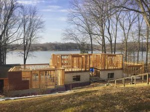 View from the north during the framing stage - Lakeside Modern Cottage - Unionville, Indiana, Lake Lemon - Christopher Short, Derek Mills, Paul Reynolds, Architects, HAUS Architecture + WERK | Building Modern - Construction Managers - Architect Custom Builders