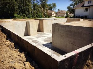 Basement foundation walls and slab have been cast and slab joints cut - Modern Colonial House - Towne Oak Estates, Steffe Drive, Carmel, Indiana - Christopher Short, Derek Mills, Paul Reynolds, Indianapolis Architects, HAUS | Architecture For Modern Lifestyles
