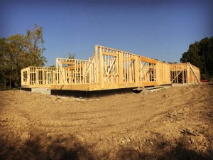 View from southeast captures first floor wall framing progress - Modern Colonial House - Towne Oak Estates, Steffe Drive, Carmel, Indiana - Christopher Short, Derek Mills, Paul Reynolds, Indianapolis Architects, HAUS | Architecture For Modern Lifestyles