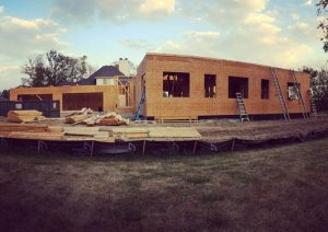 First floor wall sheathing underway in this west elevation - Modern Colonial House - Towne Oak Estates, Steffe Drive, Carmel, Indiana - Christopher Short, Derek Mills, Paul Reynolds, Indianapolis Architects, HAUS | Architecture For Modern Lifestyles