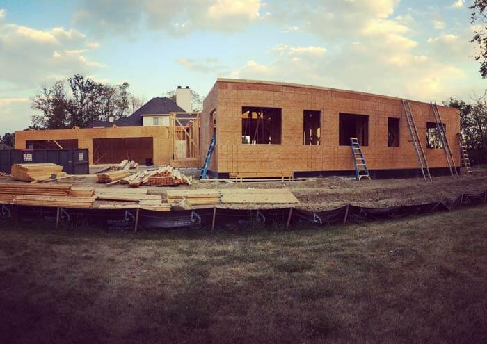First floor wall sheathing underway in this west elevation - Modern Colonial House - Towne Oaks Estates, Steffe Drive, Carmel, Indiana - Christopher Short, Derek Mills, Paul Reynolds, Indianapolis Architects, HAUS | Architecture For Modern Lifestyles