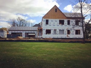 West elevation view with new roof framing mostly completed - Modern Colonial House - Towne Oak Estates, Steffe Drive, Carmel, Indiana - Christopher Short, Derek Mills, Paul Reynolds, Indianapolis Architects, HAUS | Architecture For Modern Lifestyles
