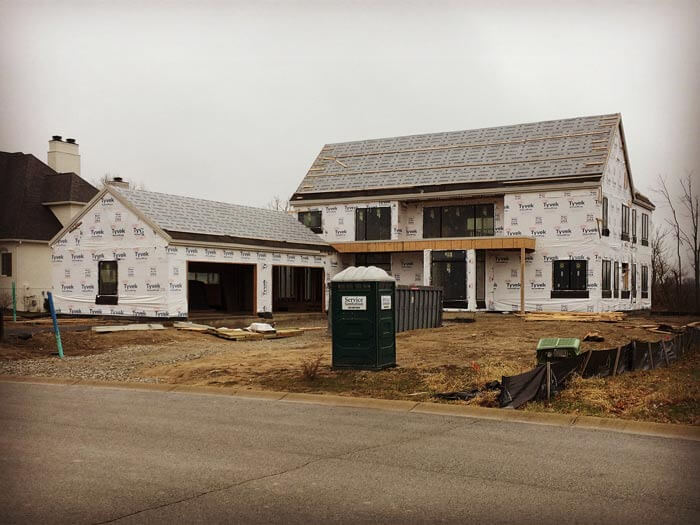 Front exterior elevations as weathered-in awaiting roofing and brick - Modern Colonial House - Towne Oaks Estates, Steffe Drive, Carmel, Indiana - Christopher Short, Derek Mills, Paul Reynolds, Indianapolis Architects, HAUS | Architecture For Modern Lifestyles