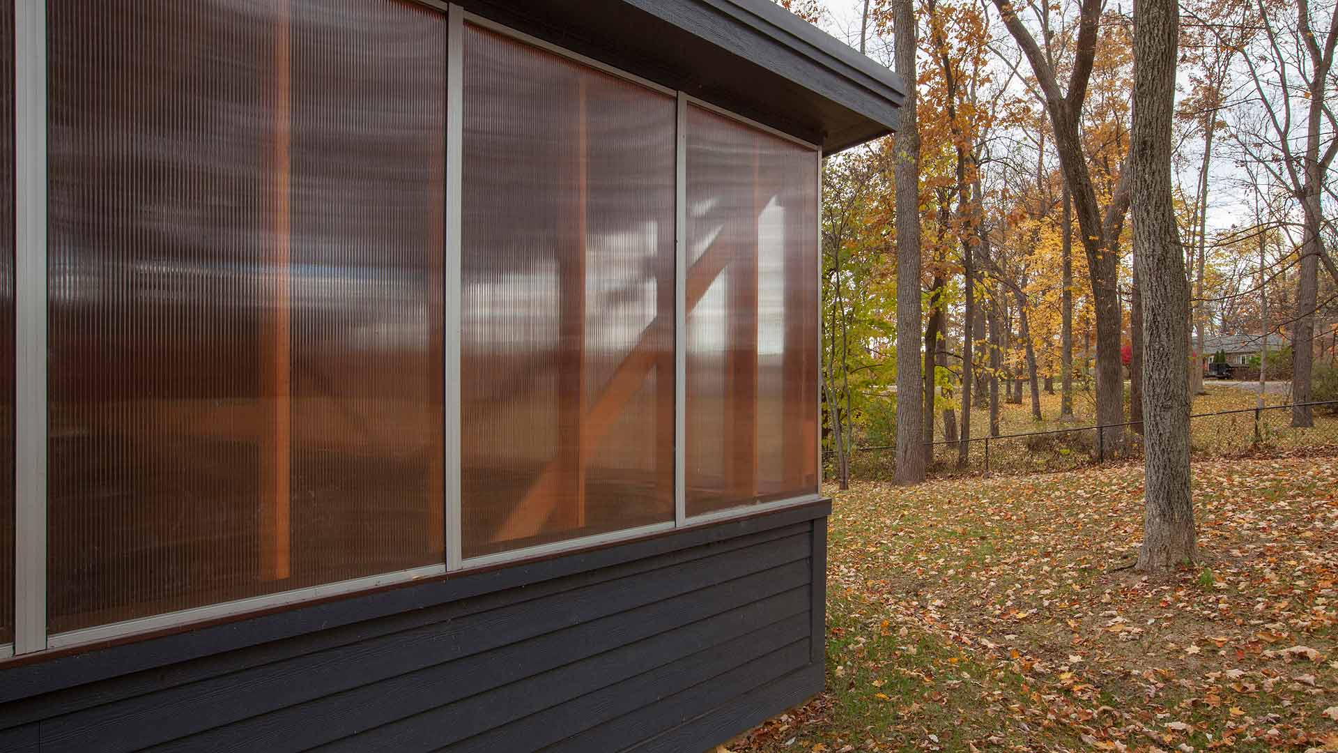 View looking west along auto workshop north elevation - translucent acrylic clerestory allows natural light to flood the garage interior while providing a dynamic architectural expression - Vintage Modern Garage - 1950's Midcentury Modern Renovation & Detached Workshop Addition, Traders Point Lake - Lakeside, 7150 Lakeside Drive, Indianapolis, Indiana - Christopher Short, Paul Reynolds, Indianapolis Architects, HAUS | Architecture For Modern Lifestyles