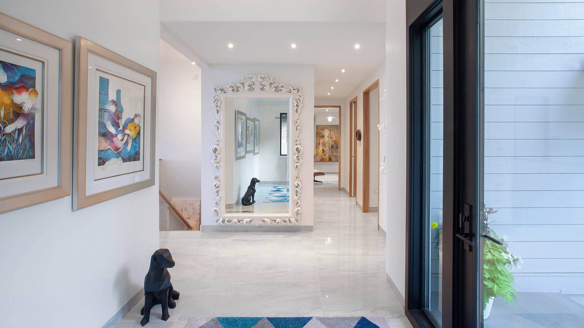 Entry foyer gallery provides openness, but privacy to living spaces from street view - colorful artwork greets visitors and introduces a modern twist on this 1980's lakeside cottage development - Modern Lakehouse Renovation - Clearwater