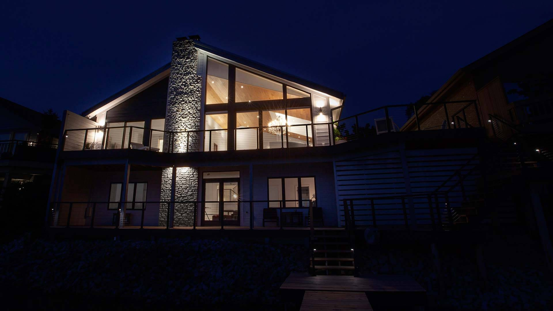 New renovation glows on view from lakeside - Modern Lakehouse Renovation - Clearwater