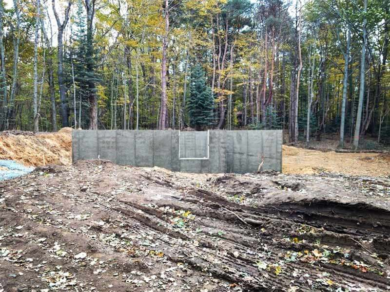 Bridge House, Garage + Basement foundation walls completed looking due East from future location of entry bridge, Douglas, Michigan - Lake Michigan - HAUS   Architecture For Modern Lifestyles, Christopher Short, Indianapolis Architect, Tom Rigney, TR Builders