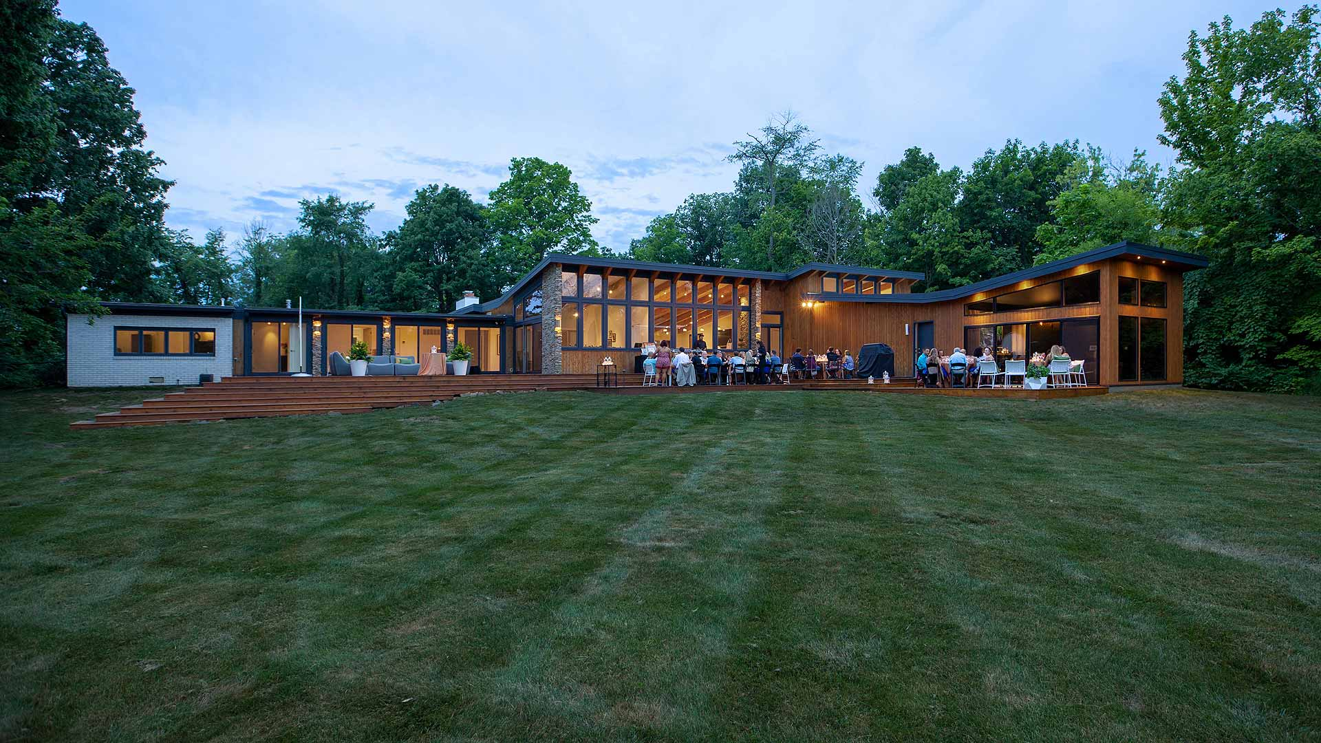 Back Elevation During Summer Party - Cigar Room - Midcentury Modern Addition - Brendonwood, Indianapolis - Christopher Short, Paul Reynolds, Architects, HAUS | Architecture For Modern Lifestyles - WERK | Building Modern - Paul Reynolds, Project Manager