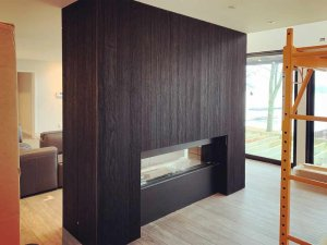 Gas fireplace enclosure is wrapped in Shou Sugi Ban Siding - Lakeside Modern Cottage - Unionville, Indiana, Lake Lemon - Christopher Short, Derek Mills, Paul Reynolds, Architects, HAUS Architecture + WERK | Building Modern - Construction Managers - Architect Custom Builders
