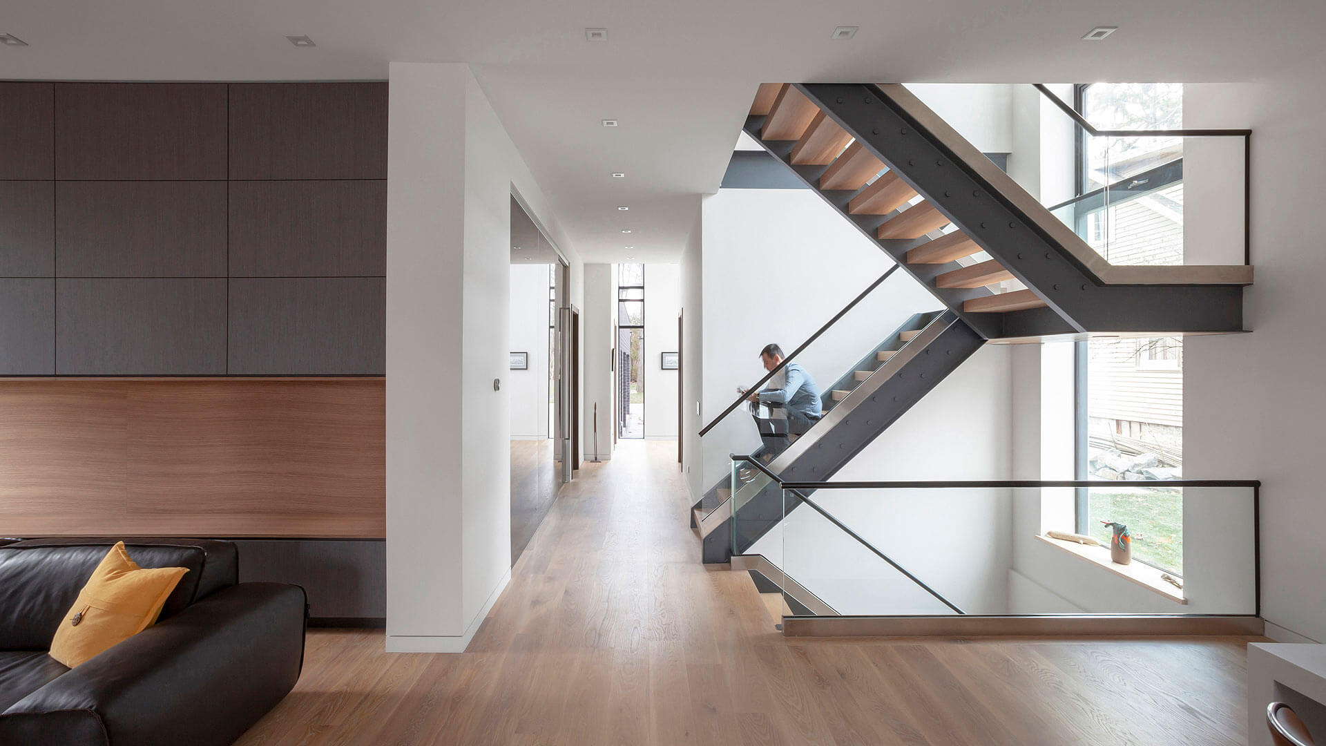 Industrial stair floats at main level adjacent to kitchen - Minimalist Modern - Indian Head Park - Chicago, Illinois - HAUS | Architecture For Modern Lifestyles, Christopher Short, Indianapolis Architect with Joe Trojanowski