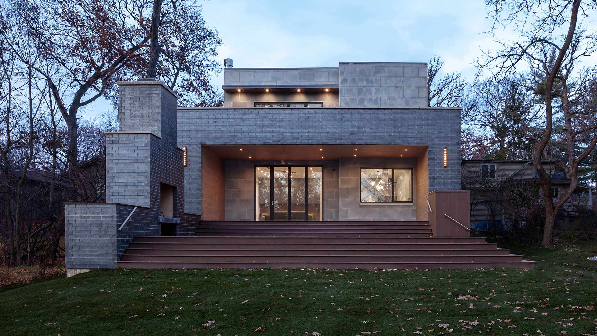 Rear Exterior Elevation includes roof deck, back deck with fireplace, and sliding Nanwall - Minimalist Modern - Indian Head Park - Chicago, Illinois - HAUS | Architecture For Modern Lifestyles, Christopher Short, Indianapolis Architect with Joe Trojanowski