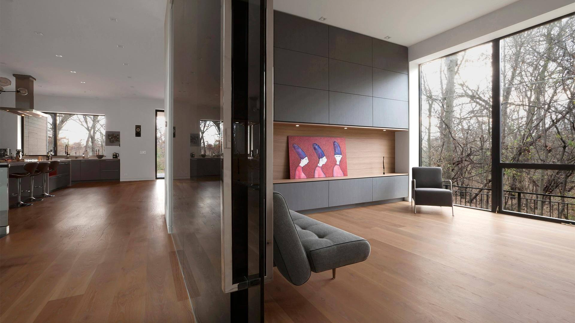 Playroom at entry hall is defined by modern storage wall and full glass walls inside and out - Minimalist Modern - Indian Head Park - Chicago, Illinois - HAUS | Architecture For Modern Lifestyles, Christopher Short, Indianapolis Architect with Joe Trojanowski