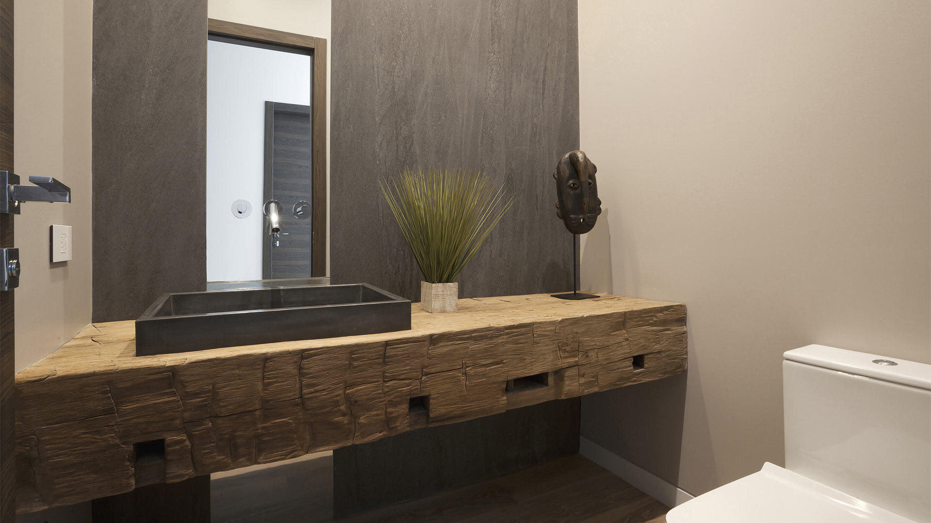Powder room features rough heavy timber wood vanity and porcelain sheet headwall with full-height mirror - Fleetwood Windows - Minimalist Modern - Indian Head Park - Chicago, Illinois - HAUS | Architecture For Modern Lifestyles, Christopher Short, Indianapolis Architect with Joe Trojanowski