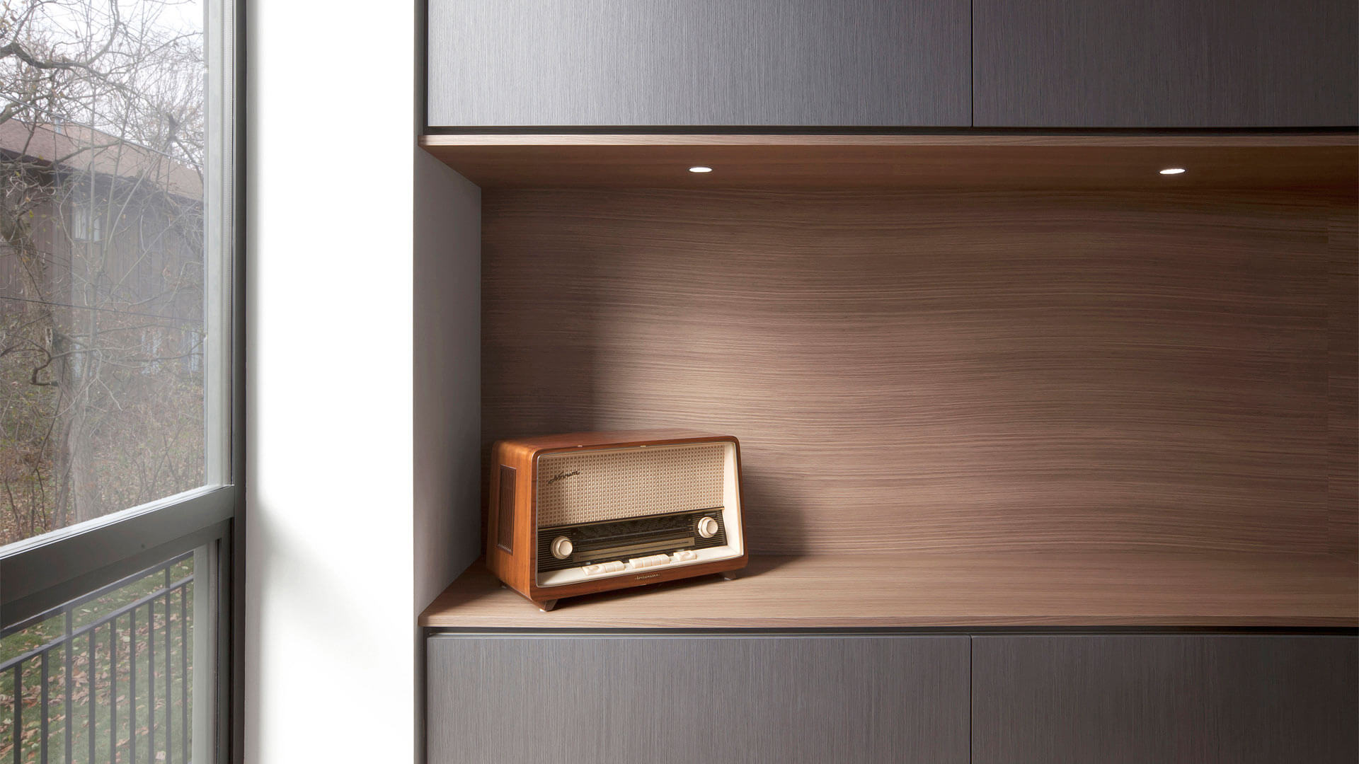 Vintage radio sits on modern built-in at living room storage wall - Fleetwood Windows - Minimalist Modern - Indian Head Park - Chicago, Illinois - HAUS   Architecture For Modern Lifestyles, Christopher Short, Indianapolis Architect with Joe Trojanowski