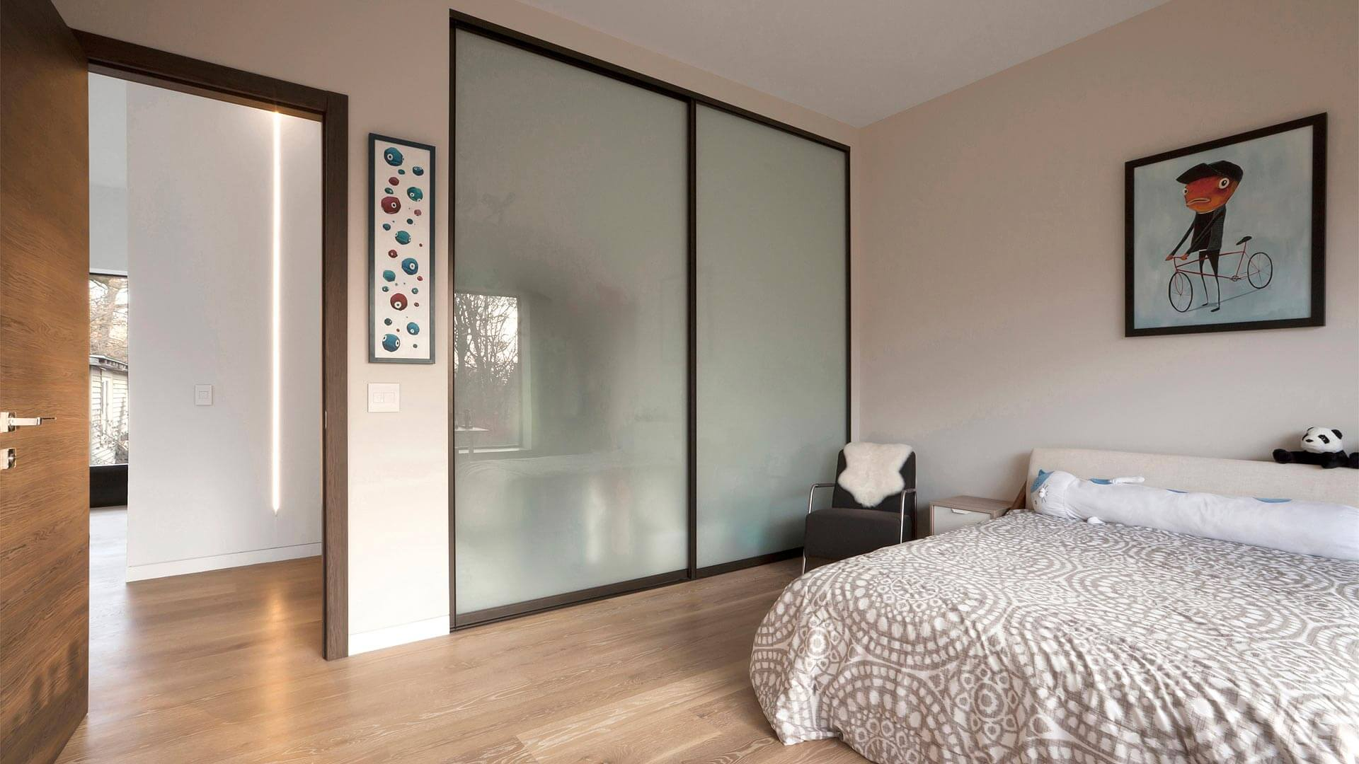 Child Bedroom includes sliding steel/glass closet doors from Germany + colorful modern wall art - Minimalist Modern - Indian Head Park - Chicago, Illinois - HAUS | Architecture For Modern Lifestyles, Christopher Short, Indianapolis Architect with Joe Trojanowski