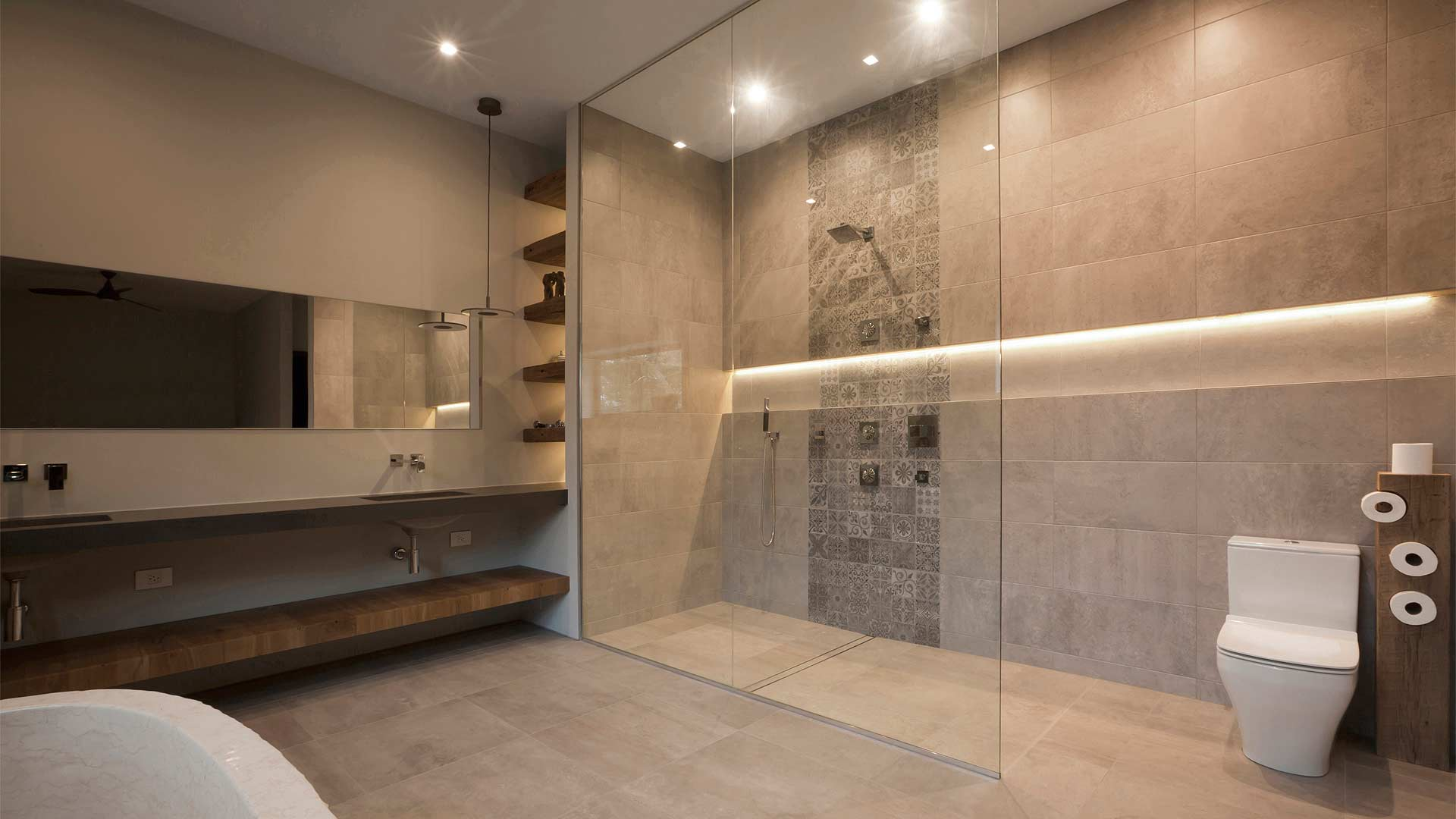 Master Spa with double vanity, massive shower, and tub carved from solid block of stone - Minimalist Modern - Indian Head Park - Chicago, Illinois - HAUS | Architecture For Modern Lifestyles, Christopher Short, Indianapolis Architect with Joe Trojanowski