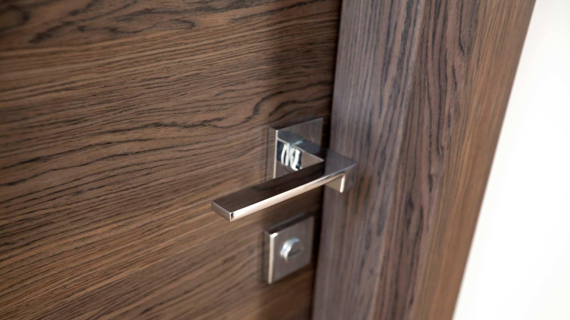 Interior Door Lever Detail (polished chrome) - Minimalist Modern - Indian Head Park - Chicago, Illinois - HAUS   Architecture For Modern Lifestyles, Christopher Short, Indianapolis Architect with Joe Trojanowski