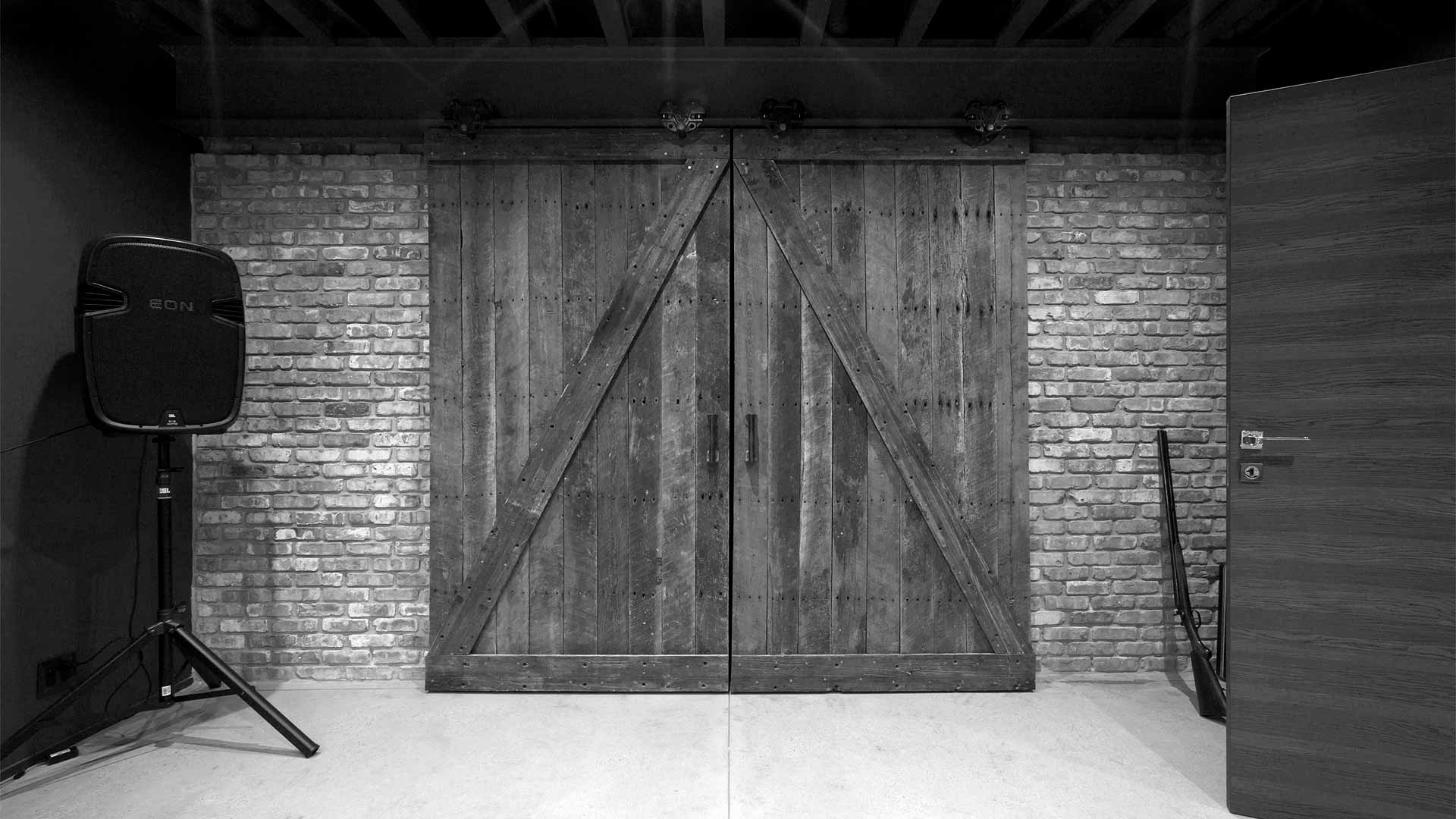 Reclaimed barn doors and hardware divide storage and studio - Minimalist Modern - Indian Head Park - Chicago, Illinois - HAUS | Architecture For Modern Lifestyles, Christopher Short, Indianapolis Architect with Joe Trojanowski
