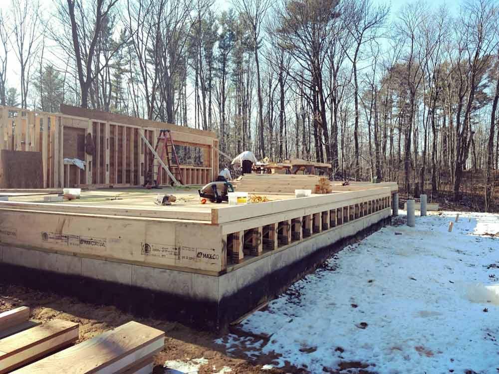 Framing Progression (view from NE corner looking W SW) - Bridge House - Douglas, Michigan - Lake Michigan - HAUS   Architecture For Modern Lifestyles, Christopher Short, Indianapolis Architect, Tom Rigney, TR Builders