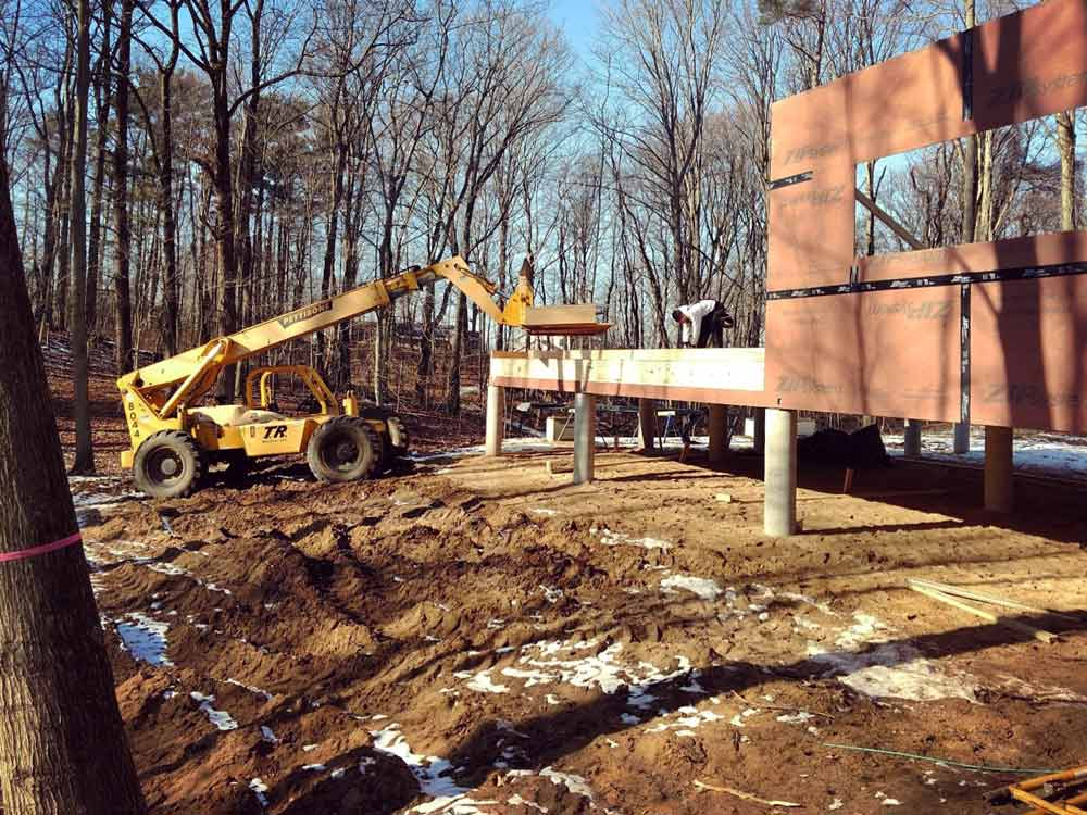 Framing Progression (view from S looking W NW) - Bridge House - Douglas, Michigan - Lake Michigan - HAUS | Architecture For Modern Lifestyles, Christopher Short, Indianapolis Architect, Tom Rigney, TR Builders