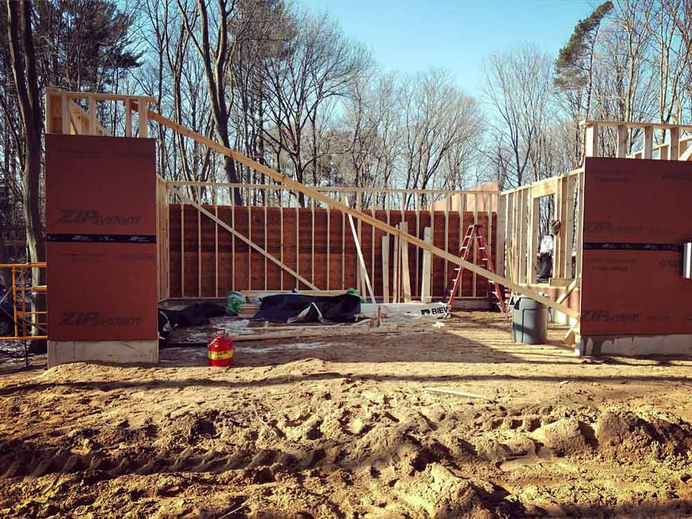 Framing Progression (E looking W) - Bridge House - Douglas, Michigan - Lake Michigan - HAUS | Architecture For Modern Lifestyles, Christopher Short, Indianapolis Architect, Tom Rigney, TR Builders