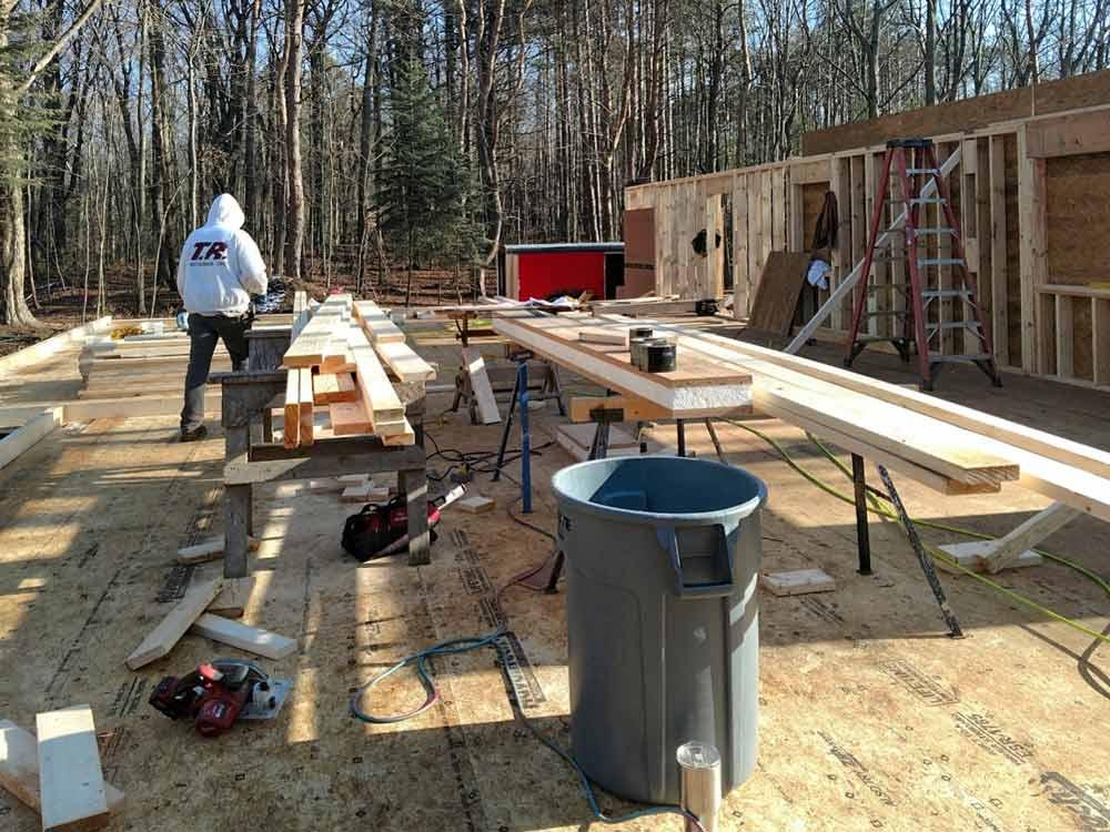 Framing Progression (W looking E) - Bridge House - Douglas, Michigan - Lake Michigan - HAUS   Architecture For Modern Lifestyles, Christopher Short, Indianapolis Architect, Tom Rigney, TR Builders