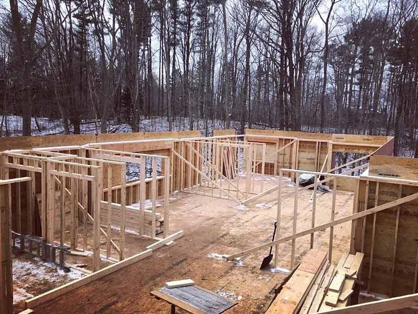 Framing Progression (NE looking W) - Bridge House - Douglas, Michigan - Lake Michigan - HAUS   Architecture For Modern Lifestyles, Christopher Short, Indianapolis Architect, Tom Rigney, TR Builders