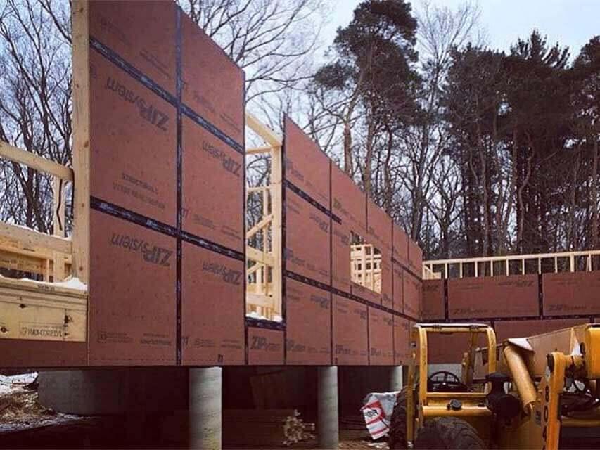 Framing Progression (SW looking E) - Bridge House - Douglas, Michigan - Lake Michigan - HAUS   Architecture For Modern Lifestyles, Christopher Short, Indianapolis Architect, Tom Rigney, TR Builders