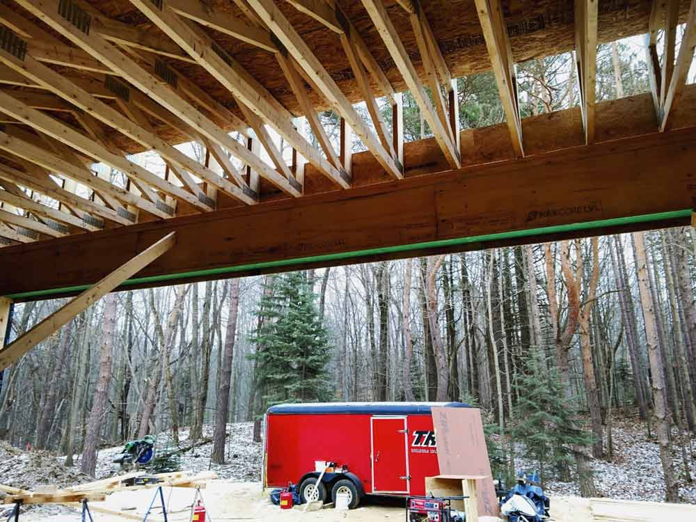 Framing Progression (view from Garage looking east) - Bridge House - Douglas, Michigan - Lake Michigan - HAUS | Architecture For Modern Lifestyles, Christopher Short, Indianapolis Architect, Tom Rigney, TR Builders