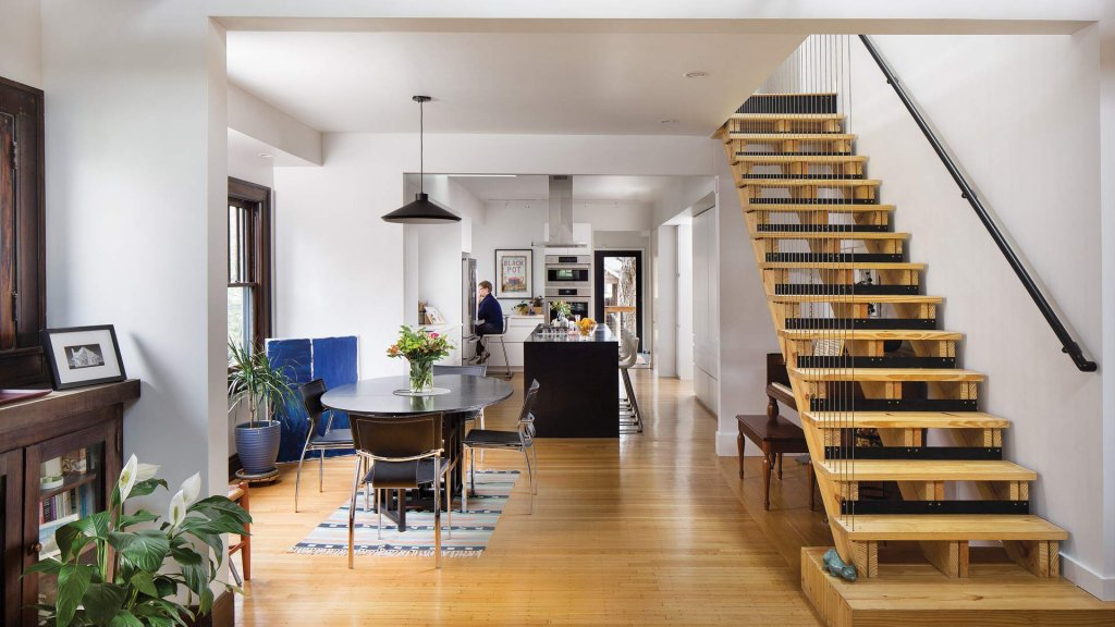 Open concept living, dining, kitchen with architectural open-riser stair, vertical cable railing, and black kitchen island - Broad Ripple Modern Craftsman - Carrollton Avenue - Indianapolis, Indiana, Christopher Short, Architect, HAUS Architecture + WERK | Building Modern - Paul Reynolds