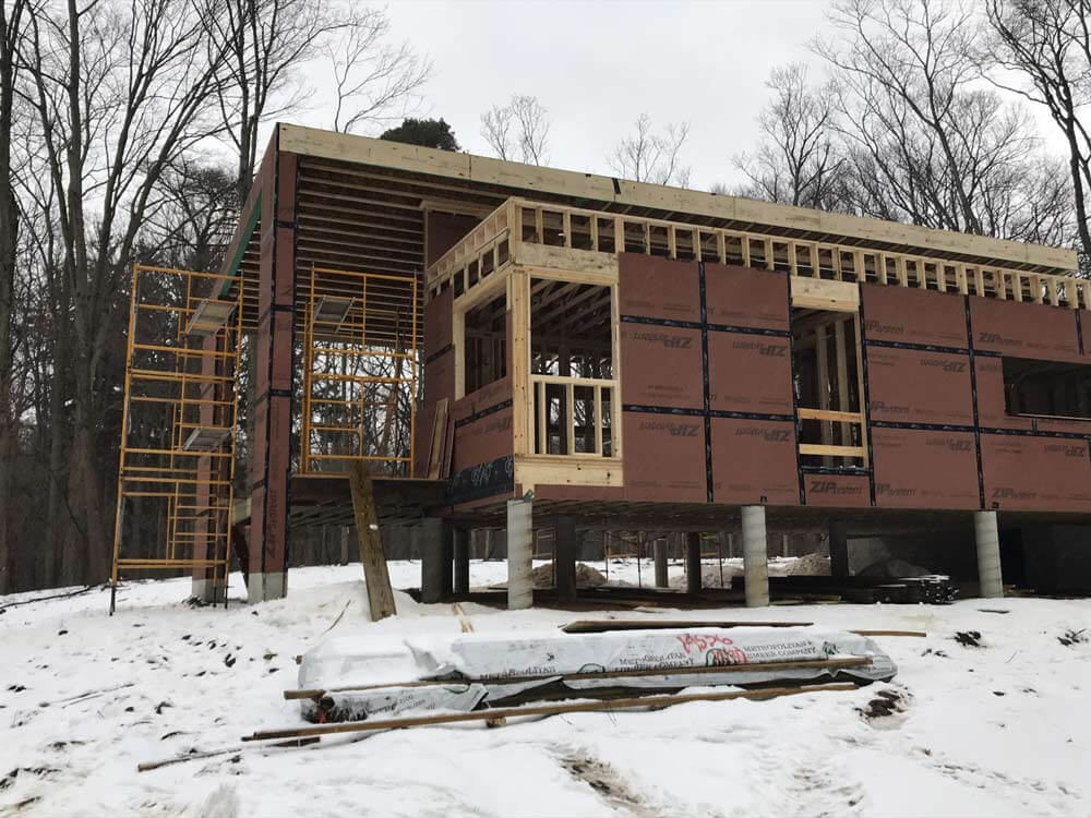 Framing Progress (South Elevation looking NNE) - covered entry porch- Bridge House - Douglas, Michigan - Lake Michigan - HAUS | Architecture For Modern Lifestyles, Christopher Short, Indianapolis Architect, Tom Rigney, TR Builders