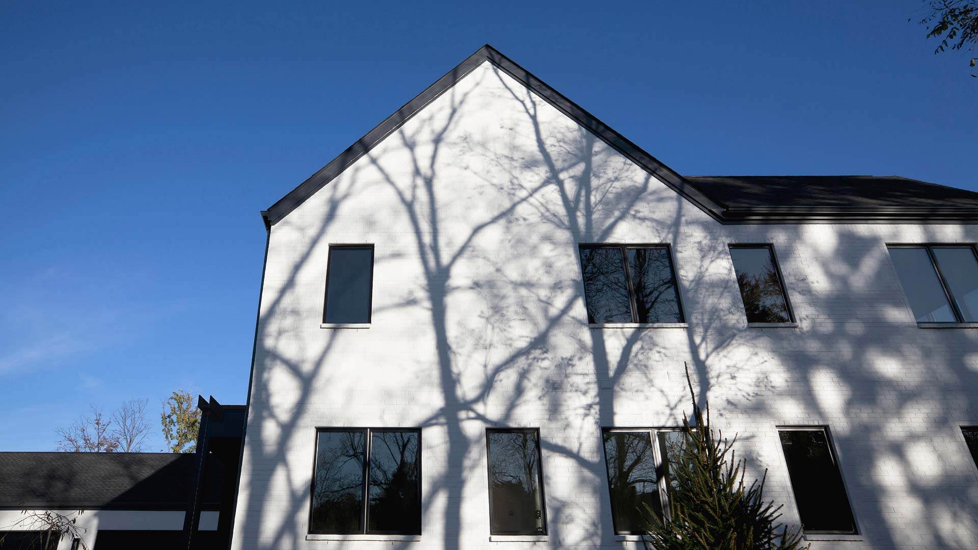 Design blends modern details with traditional gable-roof massing and materials - Towne Oak Estates, Steffe Drive, Carmel, Indiana - Christopher Short, Derek Mills - Indianapolis Architects, HAUS | Architecture For Modern Lifestyles