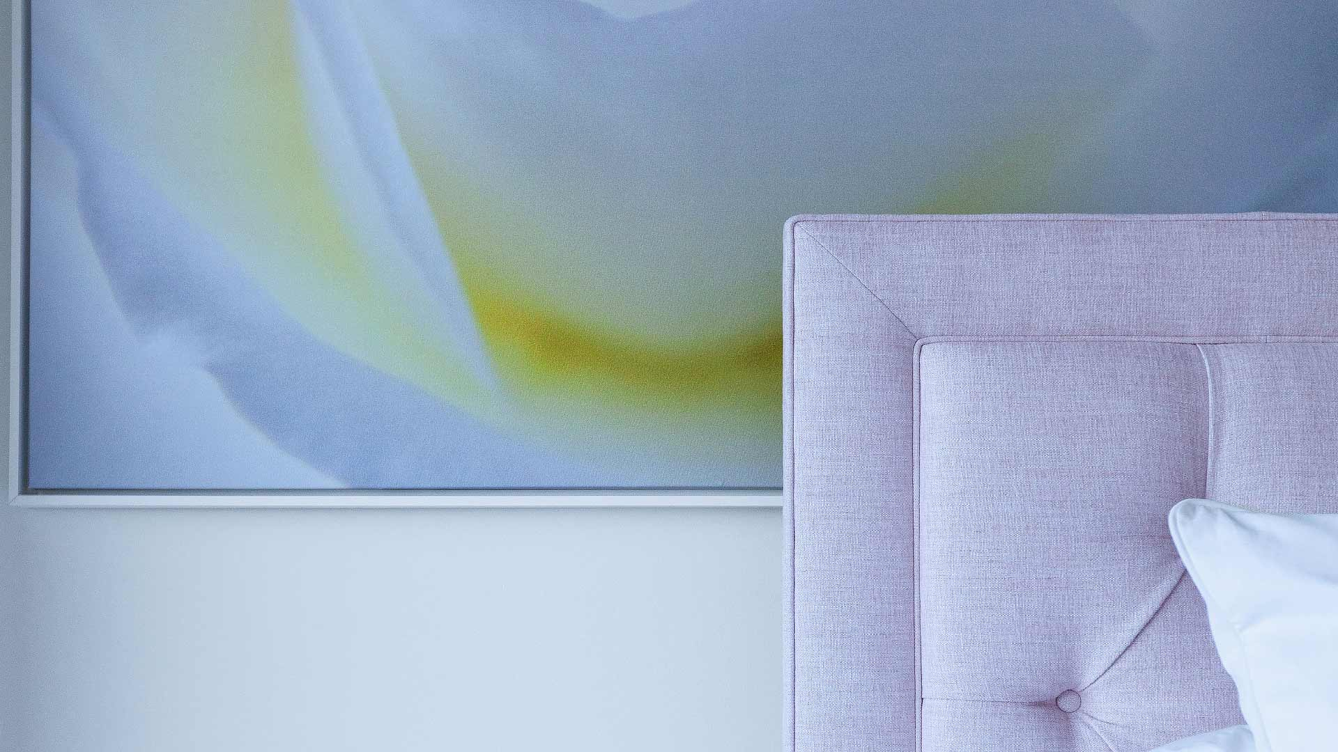 Fabric headboard overlaps large pastel artwork - Modern Lakehouse Renovation - Clearwater - HAUS | Architecture For Modern Lifestyles - Christopher Short, Architect - Derek Mills, Project manager - WERK | Building Modern (Construction Manager + Custom Builder)