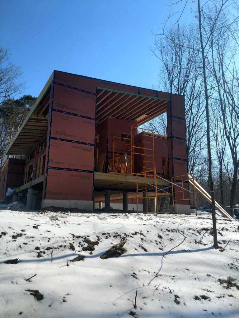 Framing Progress (West Elevation looking ESE) - covered entry porch- Bridge House - Douglas, Michigan - Lake Michigan - HAUS   Architecture For Modern Lifestyles, Christopher Short, Indianapolis Architect, Tom Rigney, TR Builders